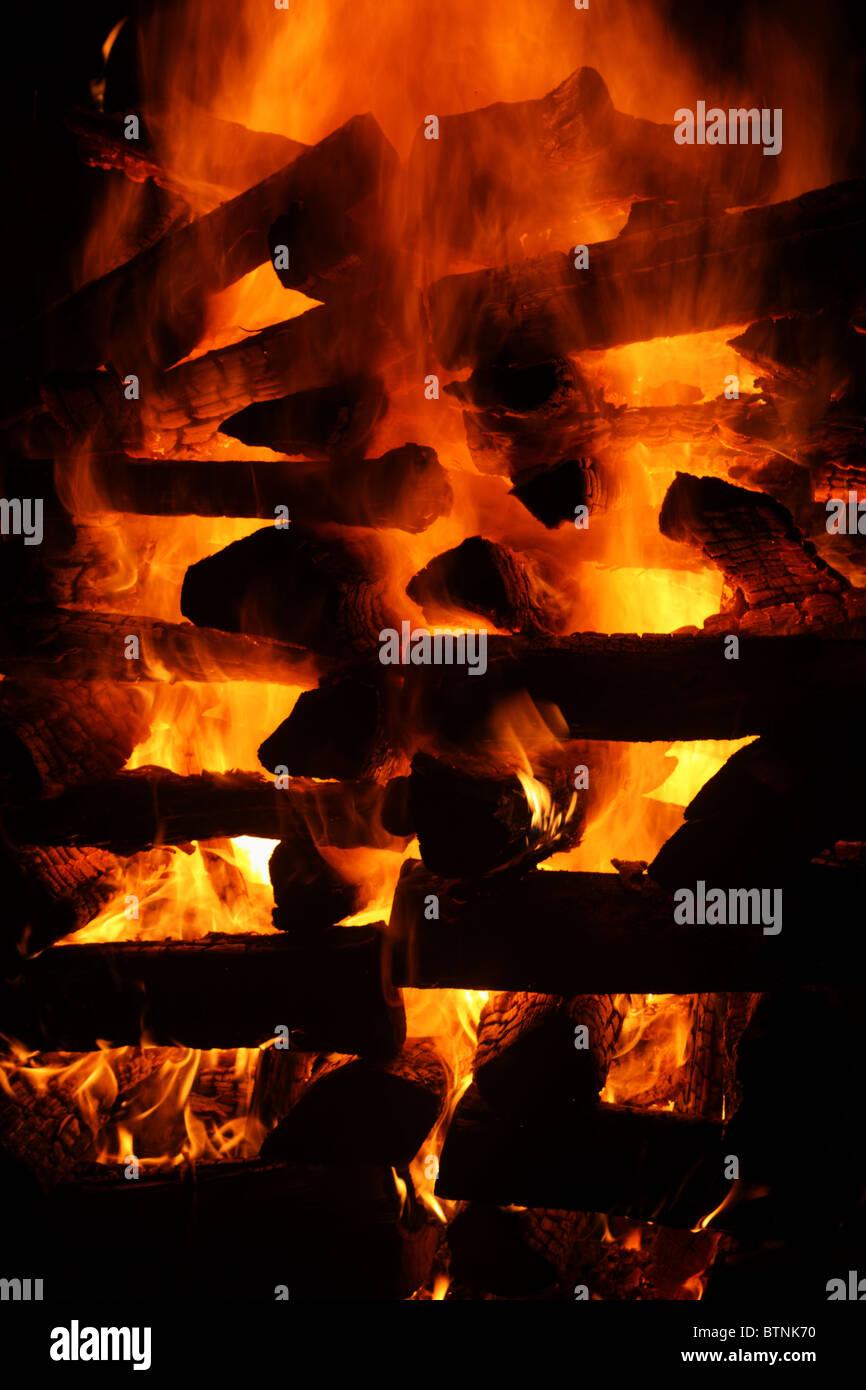 blazing log bonfire detail with black background - Stock Image