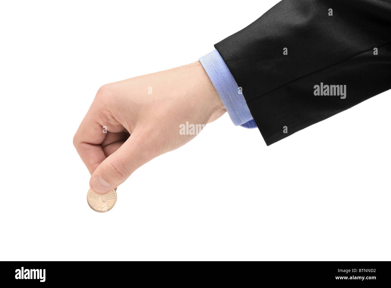 Person holding a coin - Stock Image