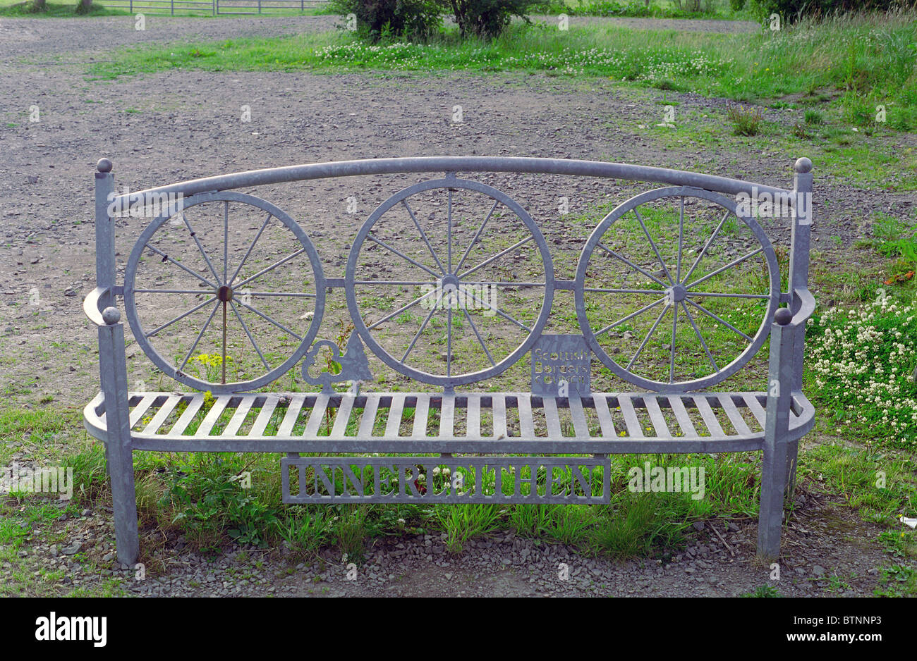 Metal Galvanised Public Bench bearing the place name Innerleithen, Borders, Scotland - Stock Image