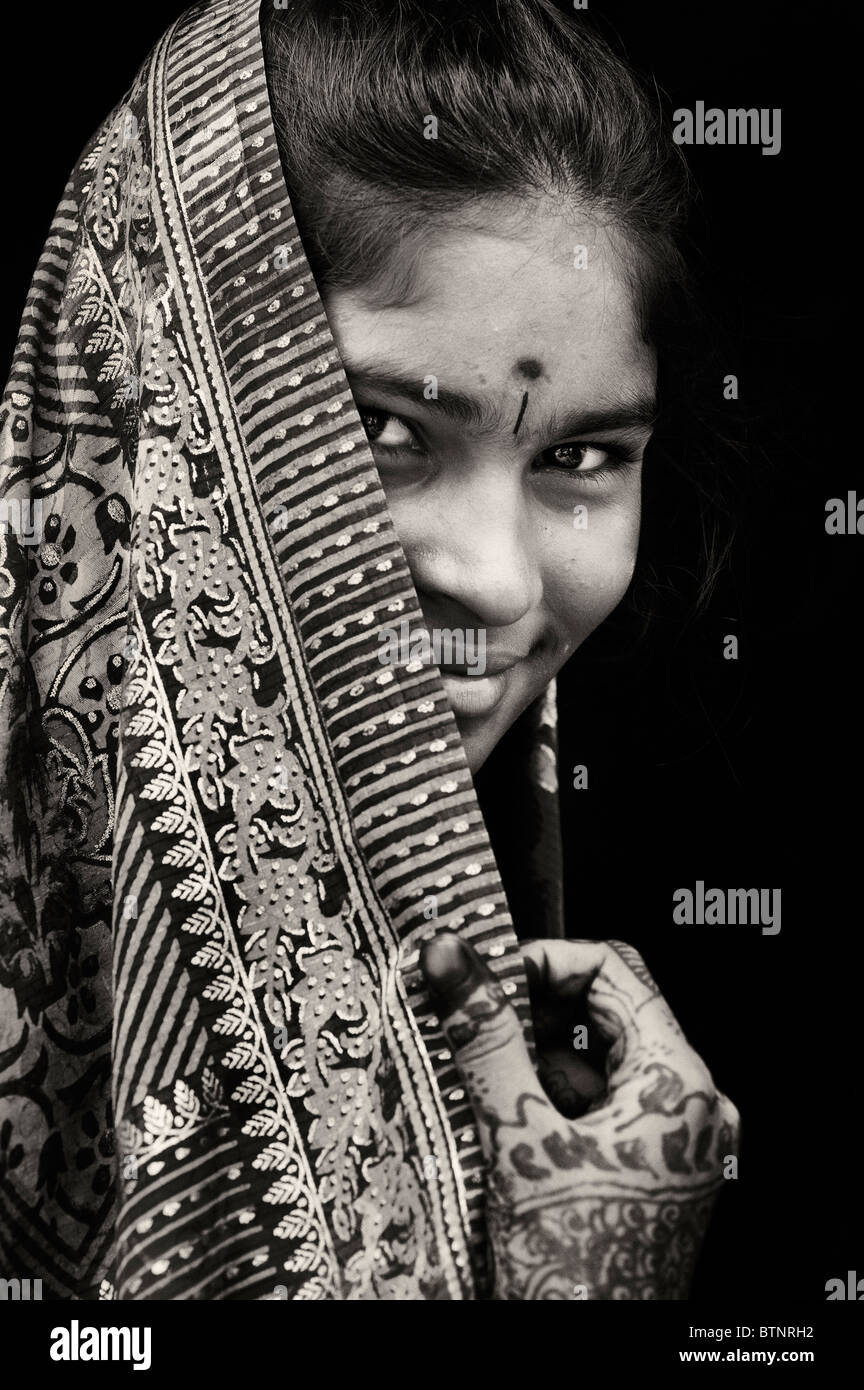 Indian girl wearing traditional silk sari with henna hands  India
