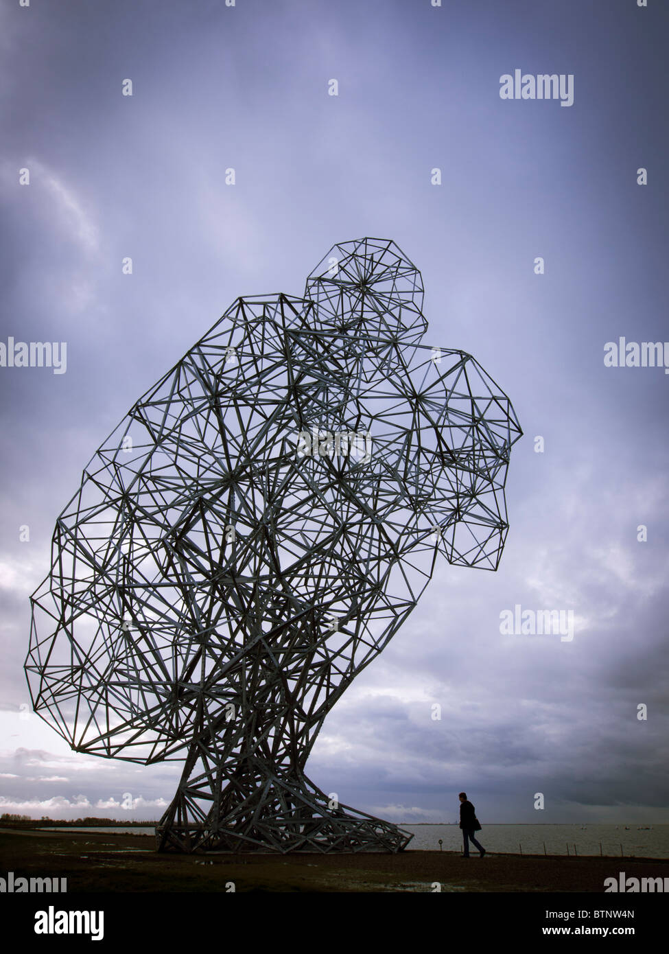 Antony Gormley's new sculpture called Exposure on sea dyke at Lelystad in The Netherlands - Stock Image