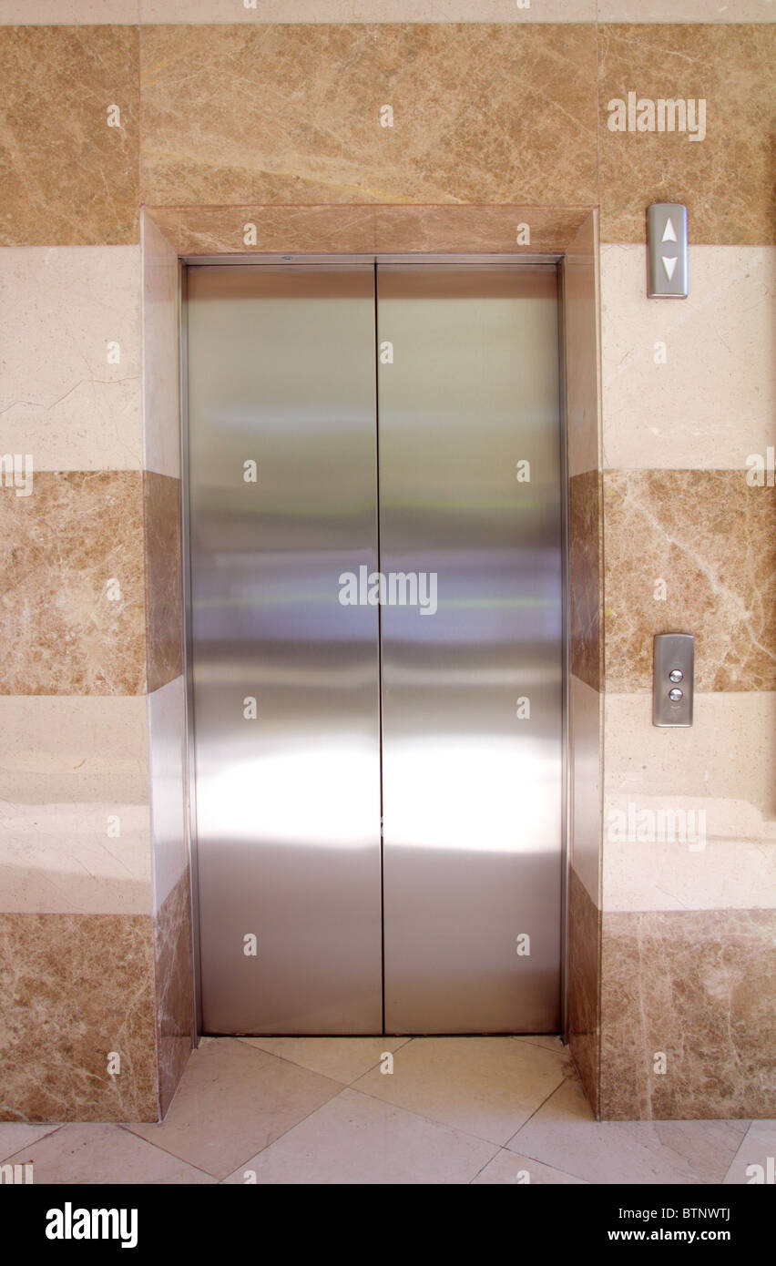 empty contemporary interior with elevator steel doors - Stock Image