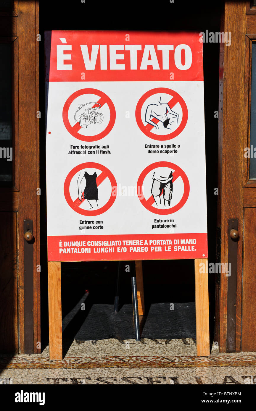 Sign prescribing what not to wear inside the Cathedral of Otranto, Puglia, Italy - Stock Image