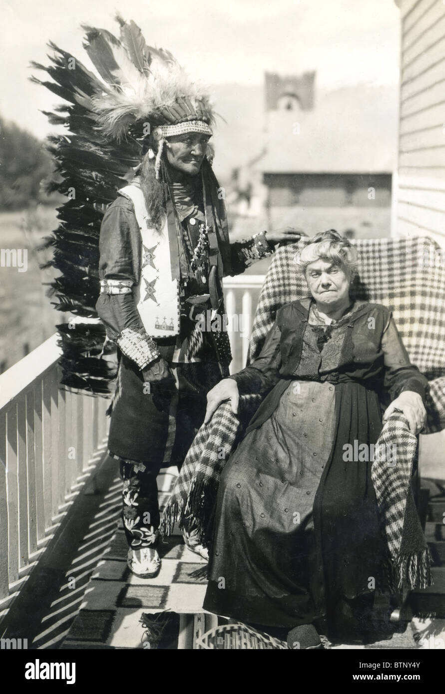 Late 1800's or early 1900's photograph showing an Indian Chief in full headdress standing next to an older - Stock Image