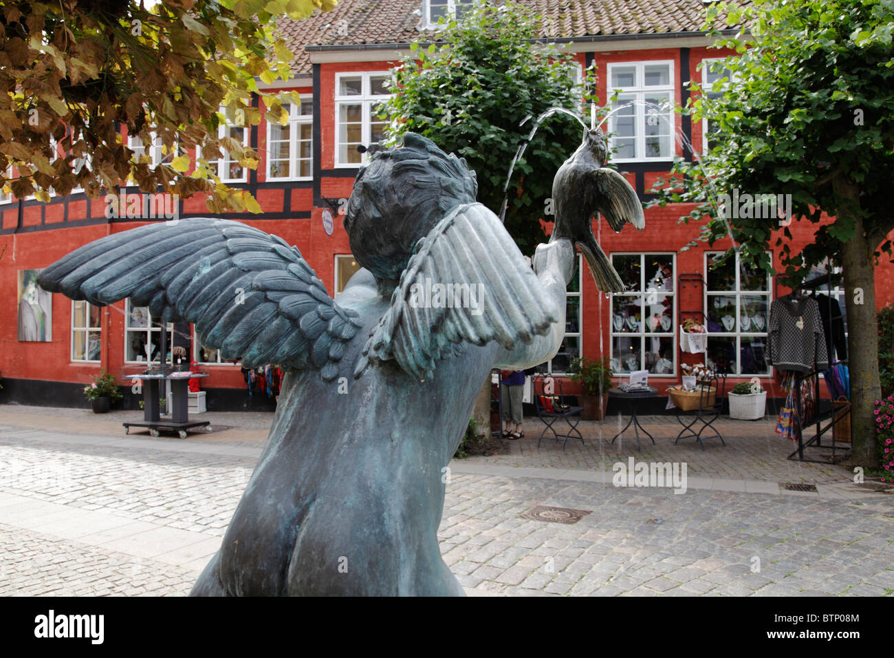 angel sculpture as a water fountain in Rudkøbing, Denmark - Stock Image