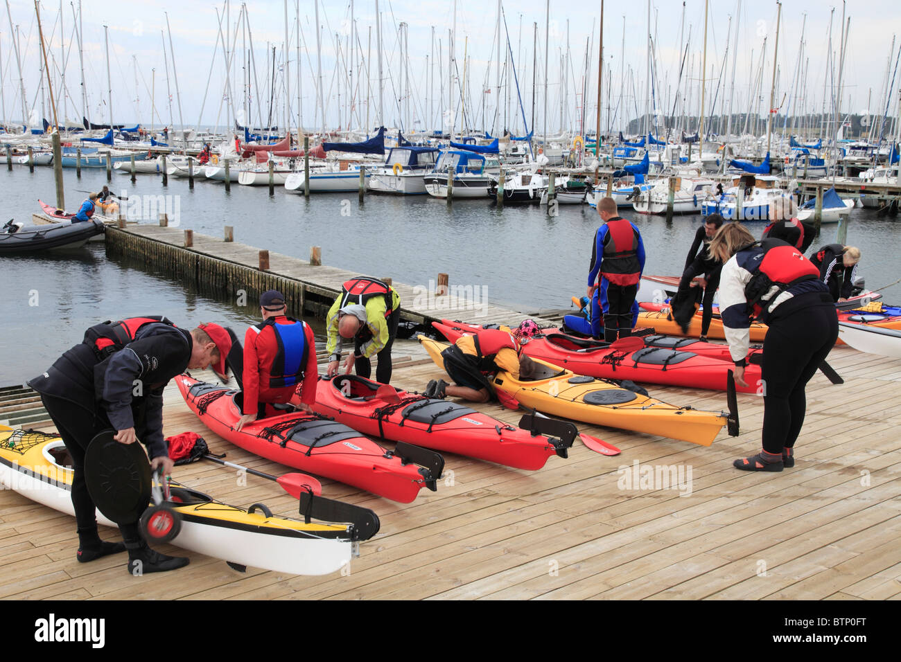 people of an Danish sports club canoeing with single seater canoes on the Baltic Sea - Stock Image