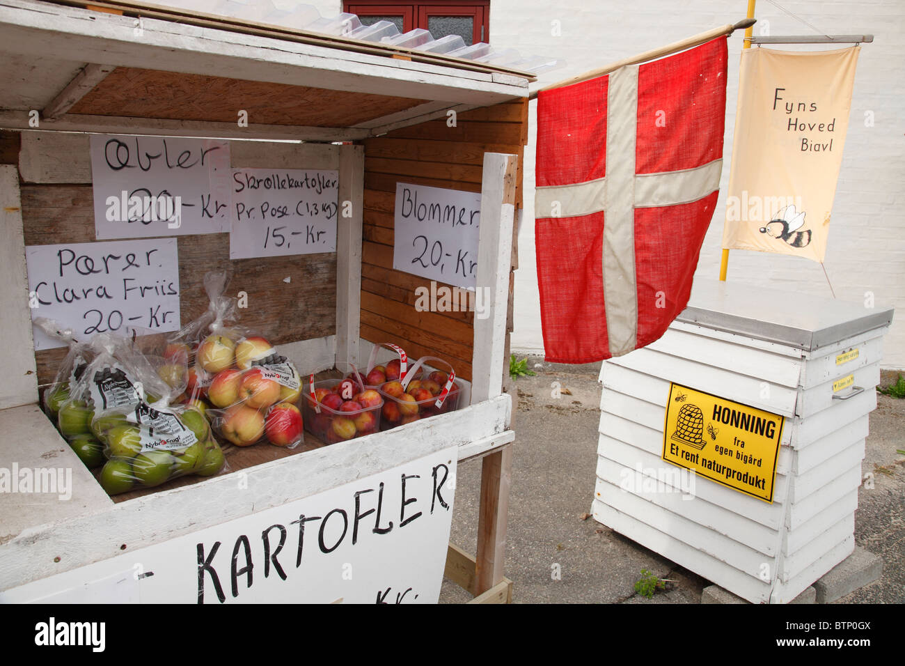 apples and honey direct marketing stand with Danish flag - Stock Image