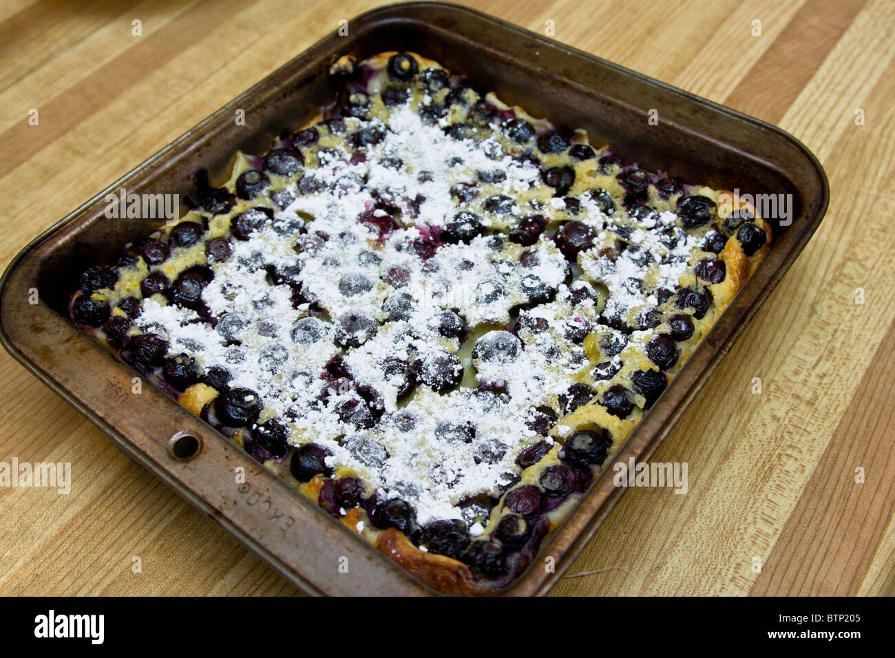 home made baked blueberry pie kitchen counter - Stock Image