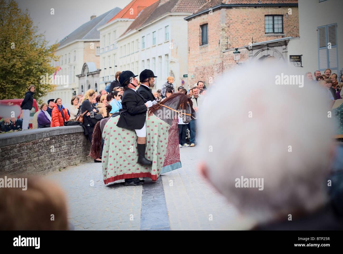 Equestrian Street entertainers, Bruges, Belgium, Europe - Stock Image