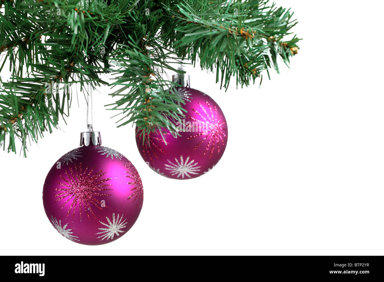 Christmas ball and green spruce branch. - Stock Image