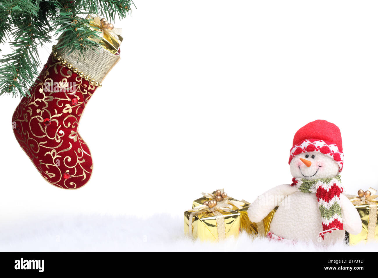 Christmas stocking and snowman with gifts on white background. - Stock Image