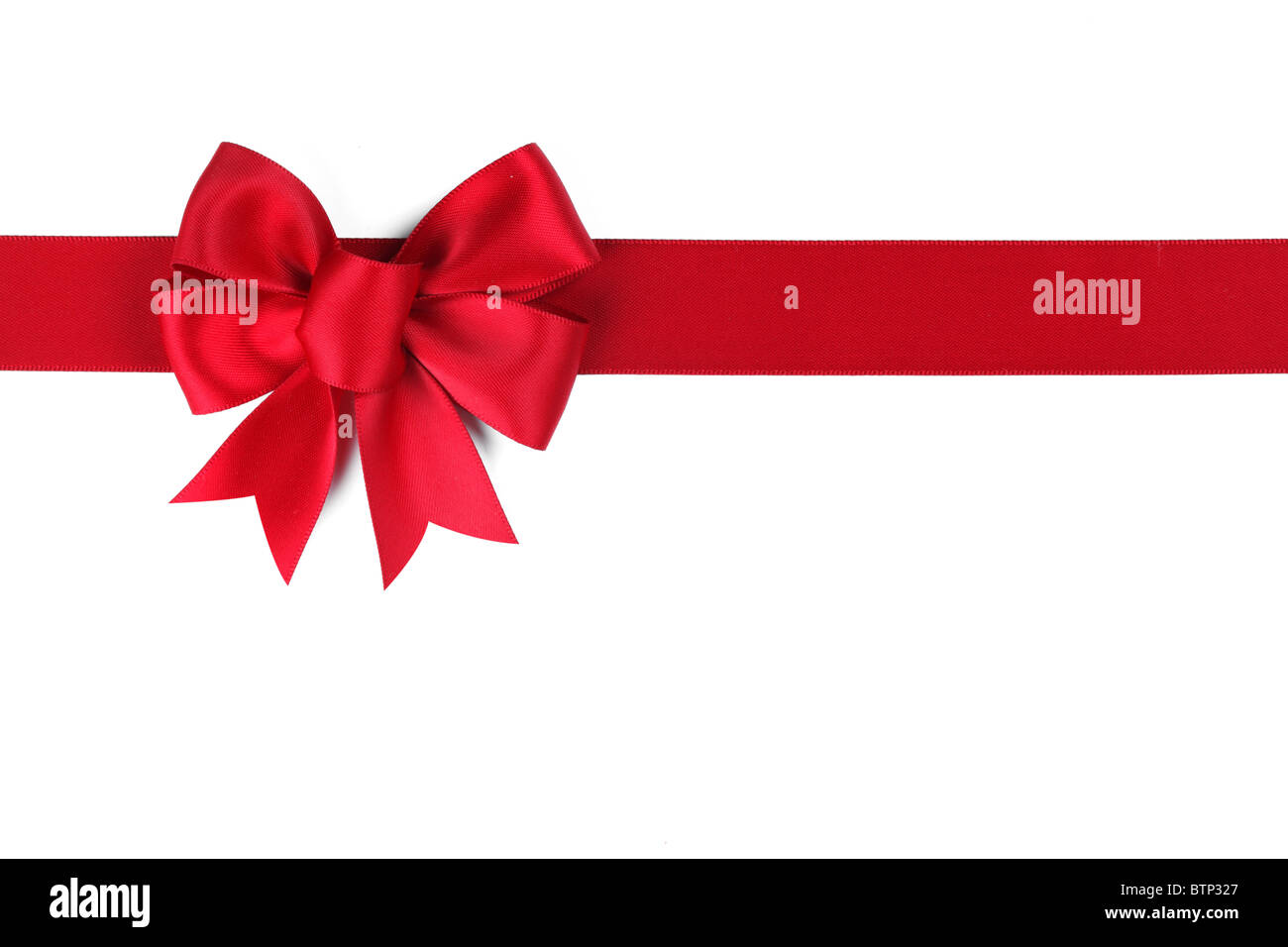 Red ribbon with bow on white - Stock Image