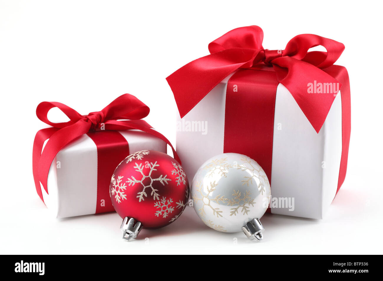 Christmas Gift Box with bauble. - Stock Image