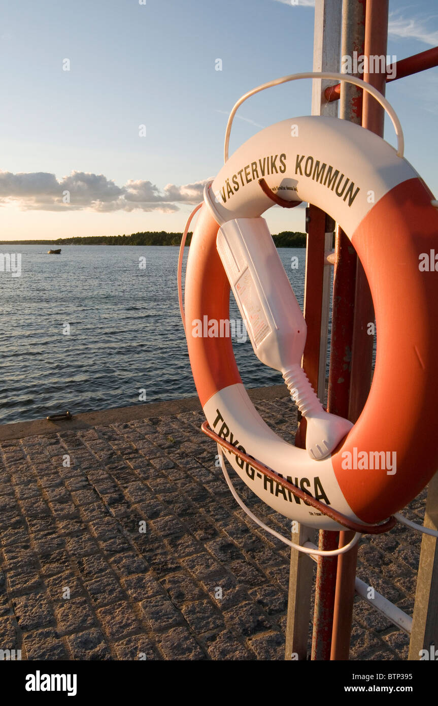 vastervik harbour sweden south east lifebelt life belt belts ring rings lifebelt lifebelts life belts belt ring - Stock Image