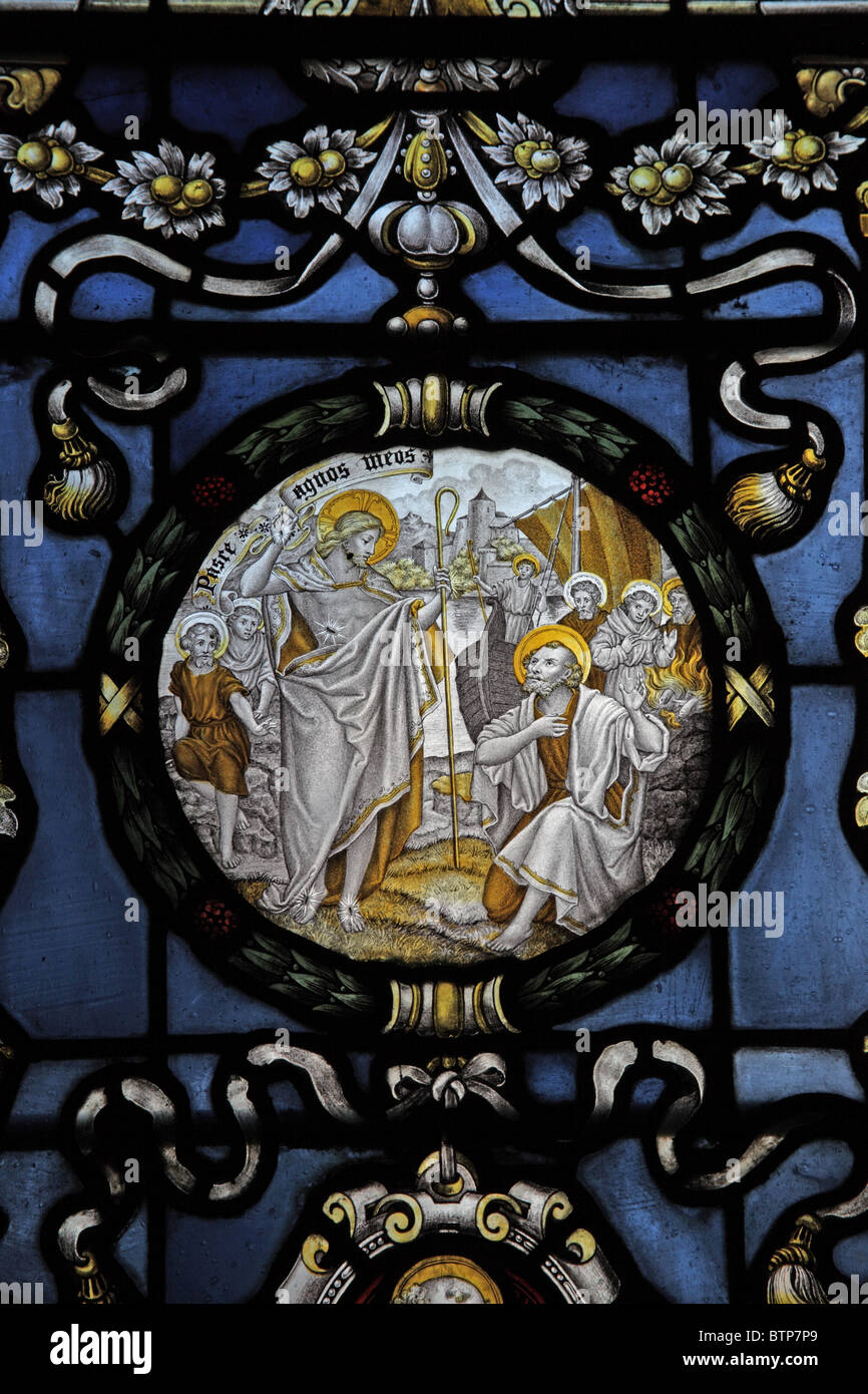 A stained glass window by C E Kempe & Co depicting Jesus' Charge to St Peter - Stock Image