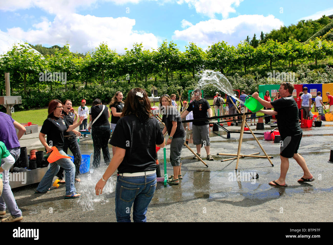 Corporate de-stress day at the Eden Project Cornwall - a money raising concept for the eco-village - Stock Image