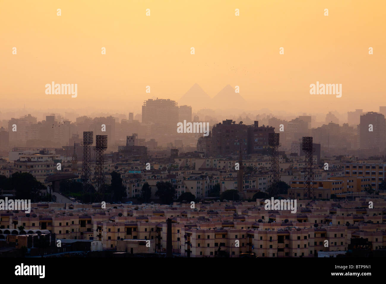 Cairo city skyline and Pyramids - Stock Image