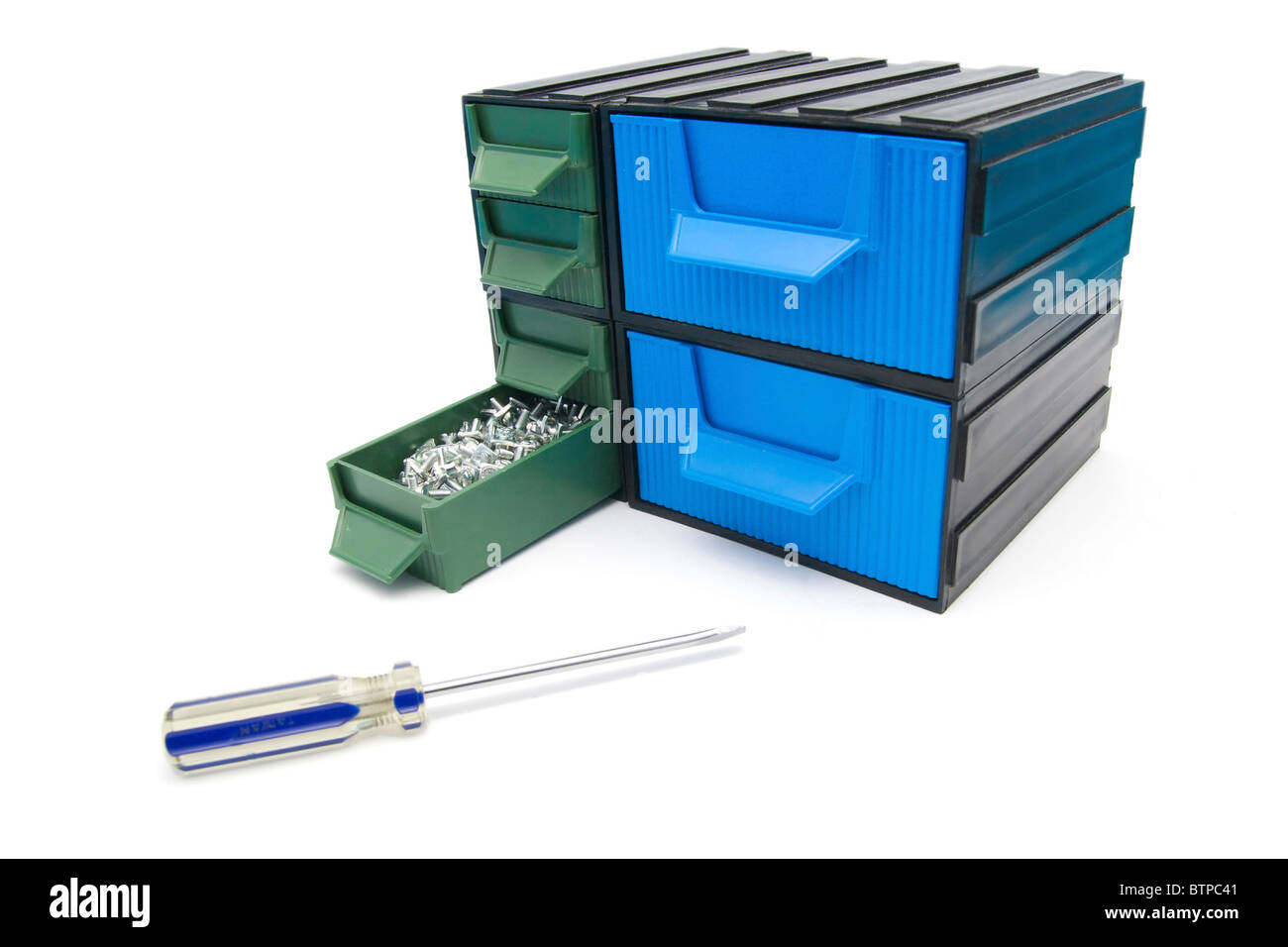 Screws box with drawers and screwdriver - Stock Image