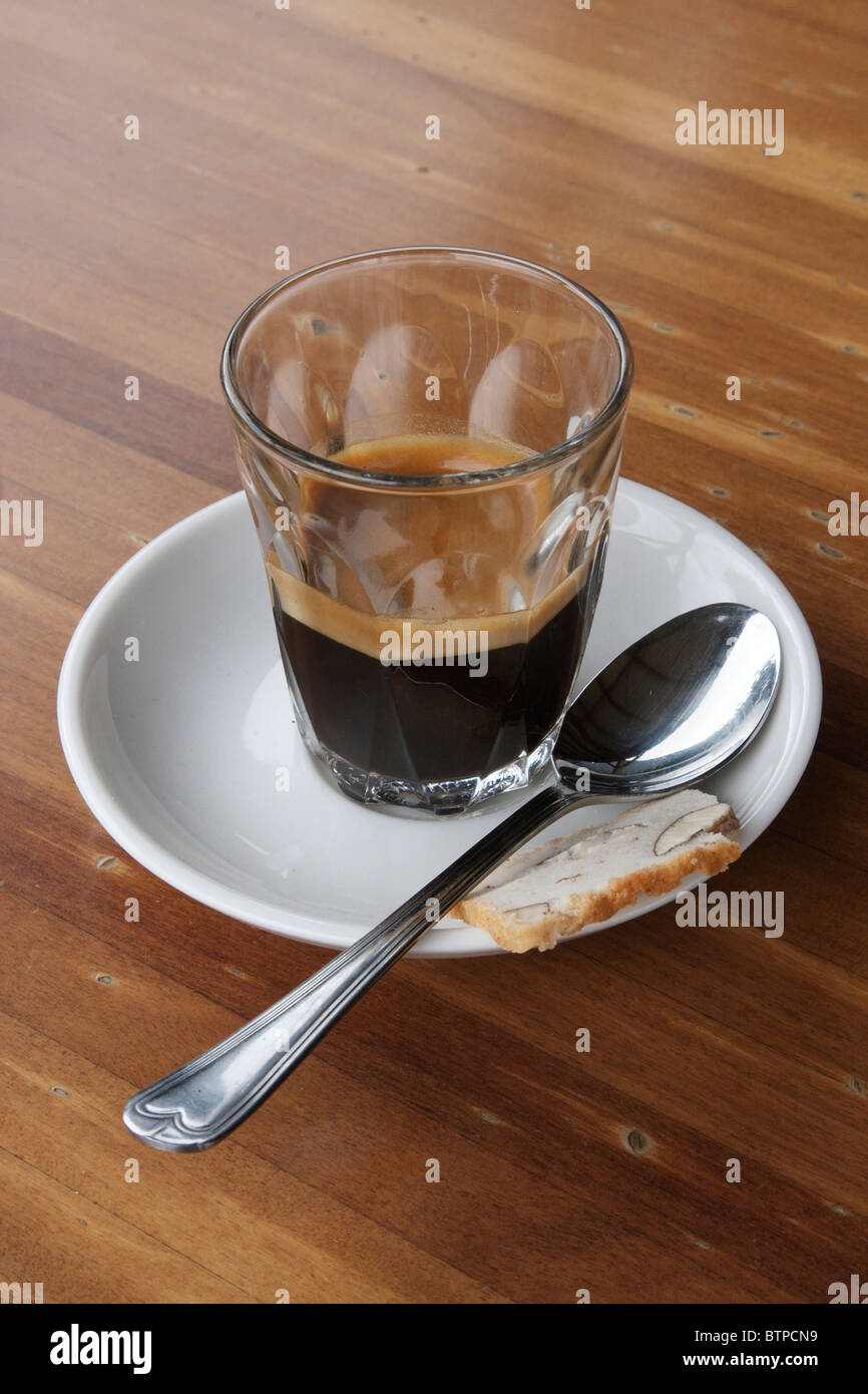 Espresso coffee with spoon - Stock Image