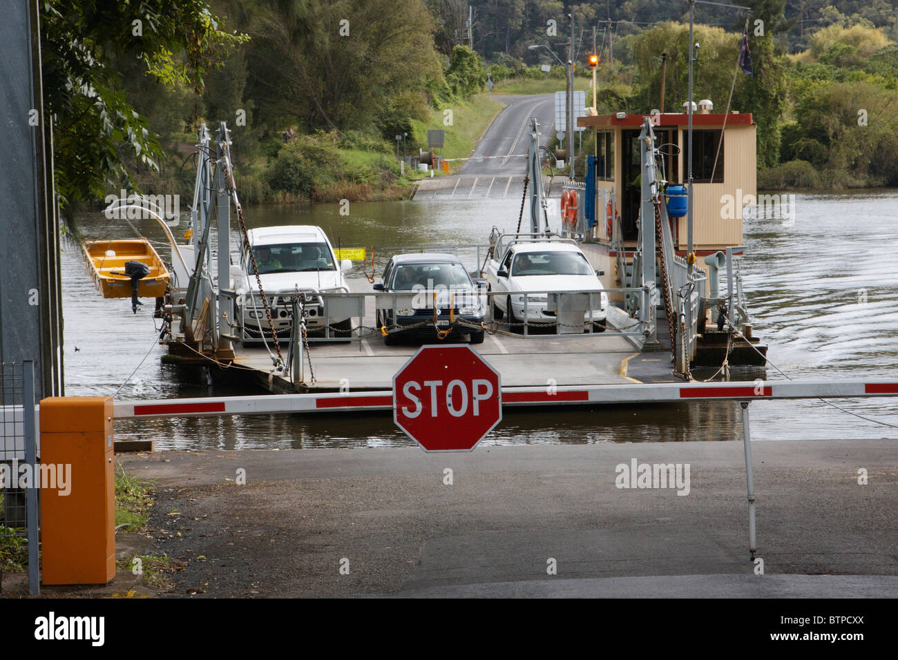 Australia, New South Wales, Hawkesbury, Sackville, Ferry with stop sign - Stock Image