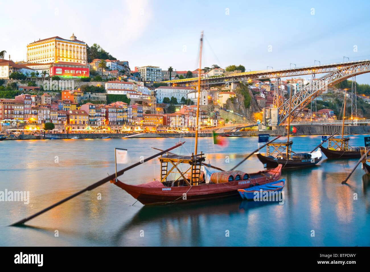 Douro River, Ponte Dom Luis I, Dusk, Porto, Portugal, Sherry Barges - Stock Image