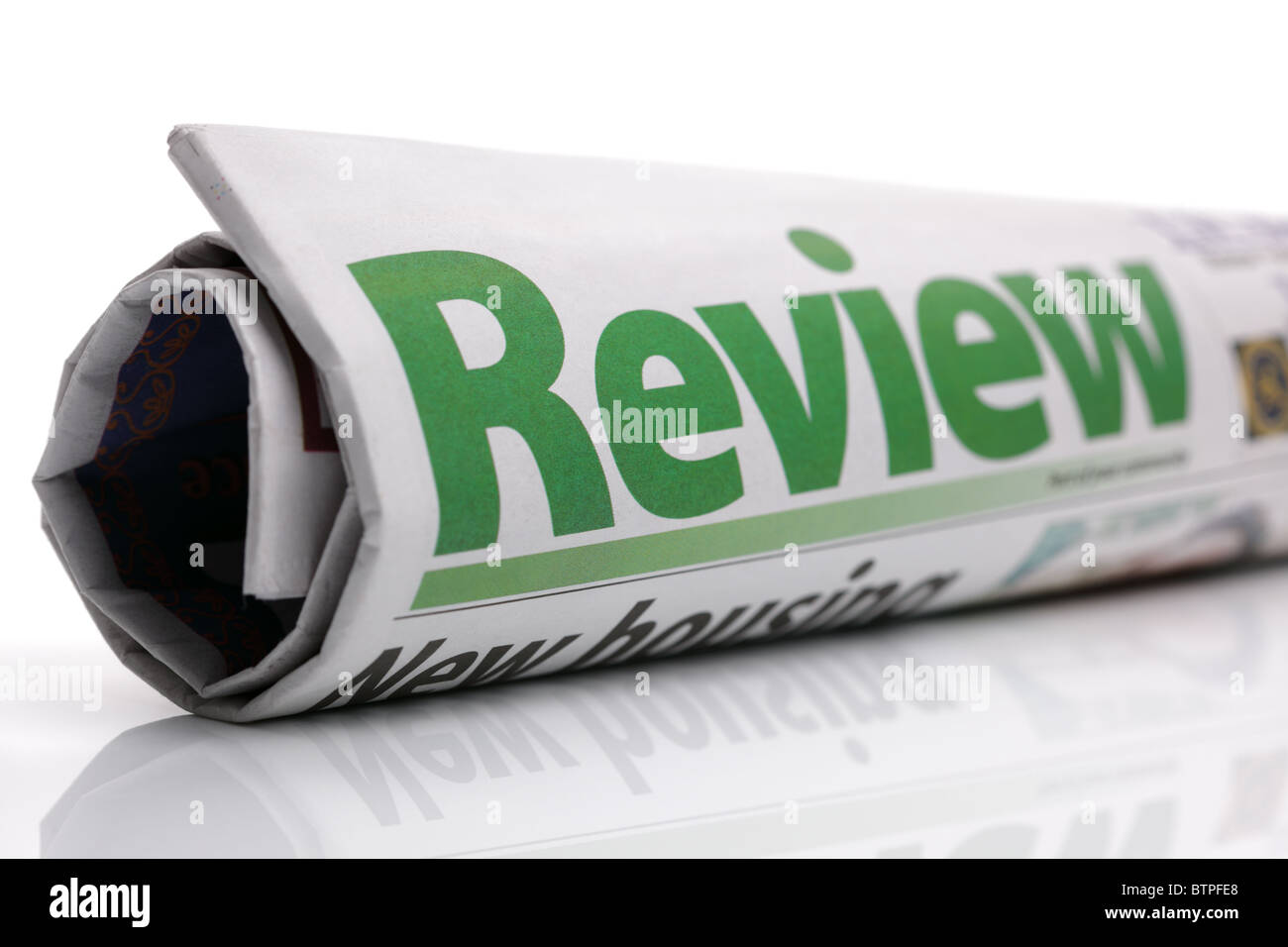 Review newspaper headline - Stock Image