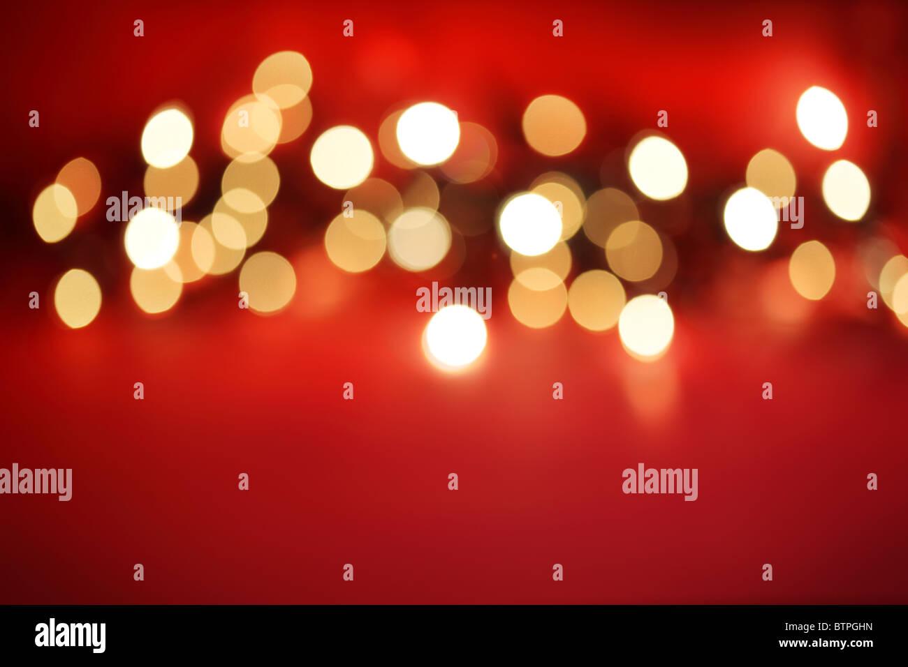 Defocussed lights on red - Stock Image