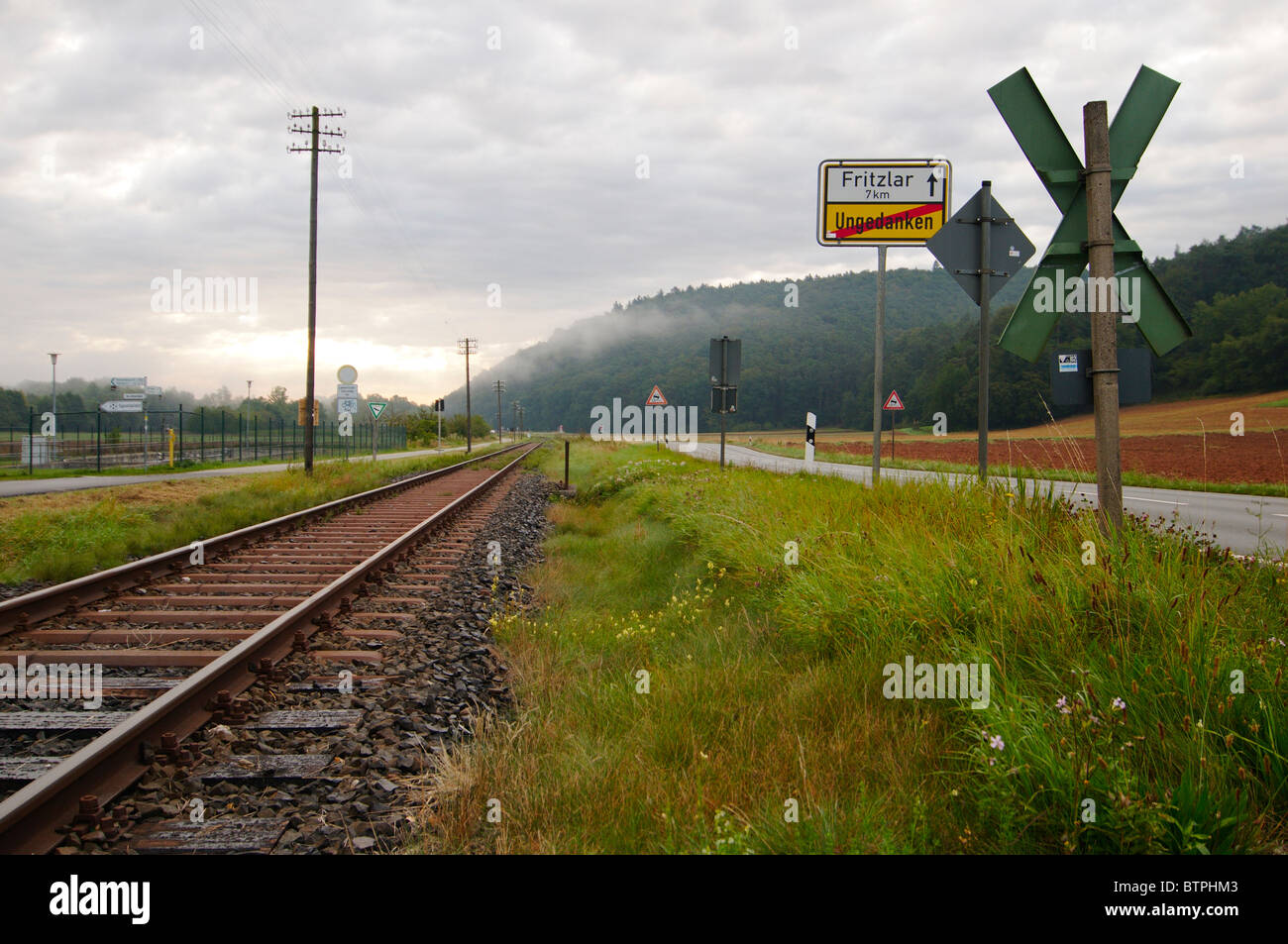Germany, Hesse, View of railway track and road - Stock Image