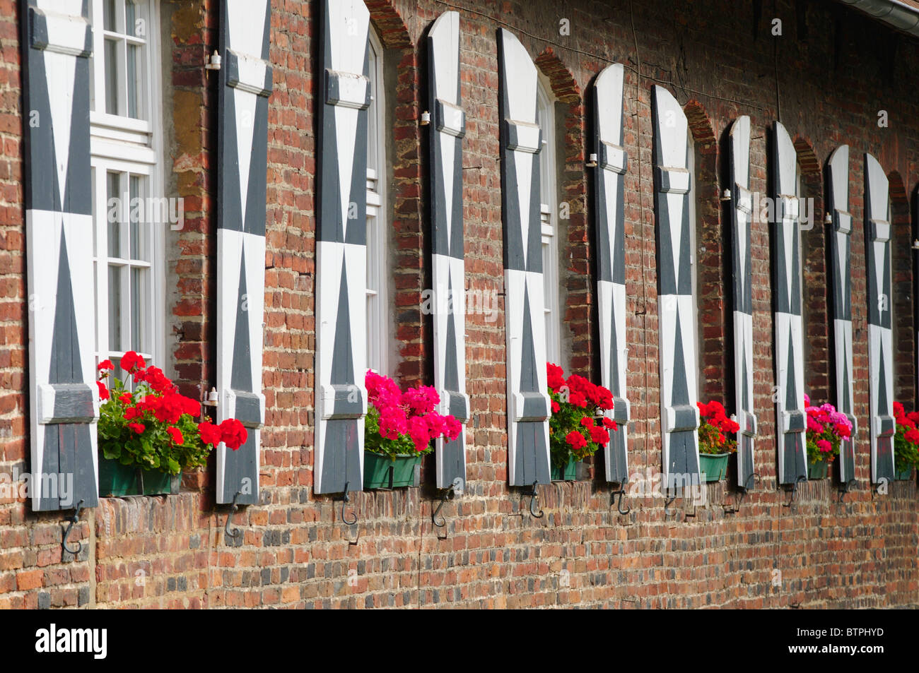 Germany, Münsterland, Schloss Lembeck, Exterior of a building with window boxes - Stock Image