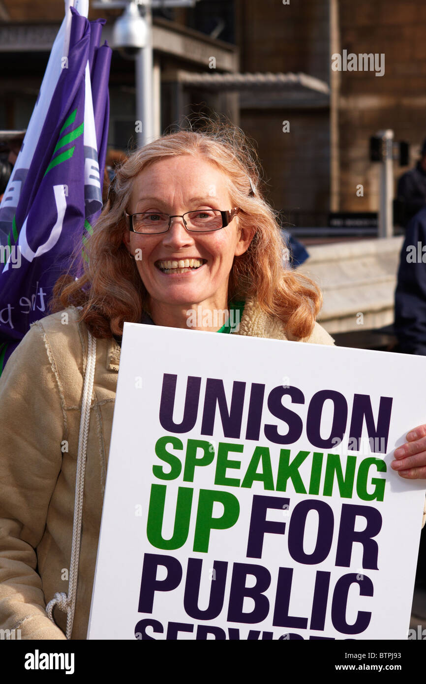 Unite member with a placard supporting public services - Stock Image
