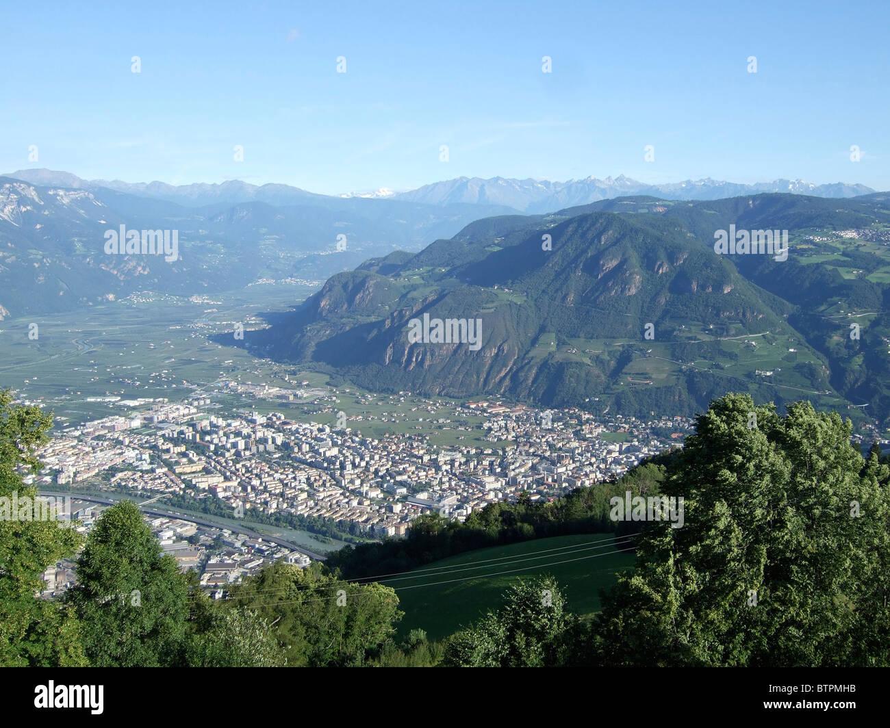 Italy, Alto Adige, Bolzano, Cityscape from hill - Stock Image
