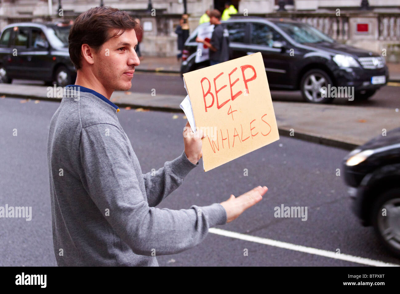 Protester during an anti-whaling protest outside the Japanese embassy - Stock Image