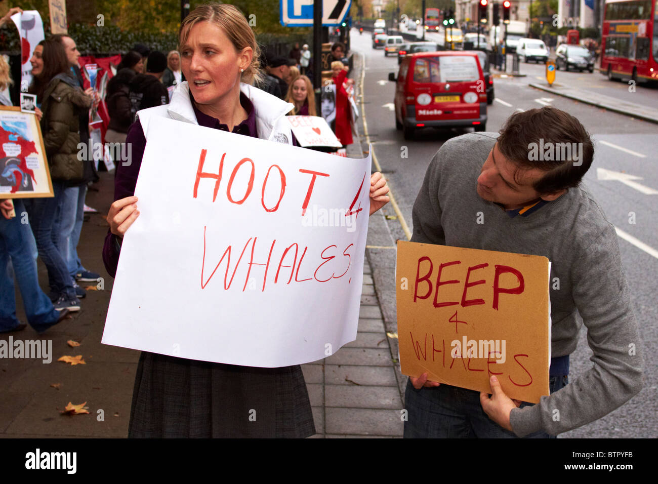 Protesters during an anti-whaling protest outside the Japanese embassy - Stock Image