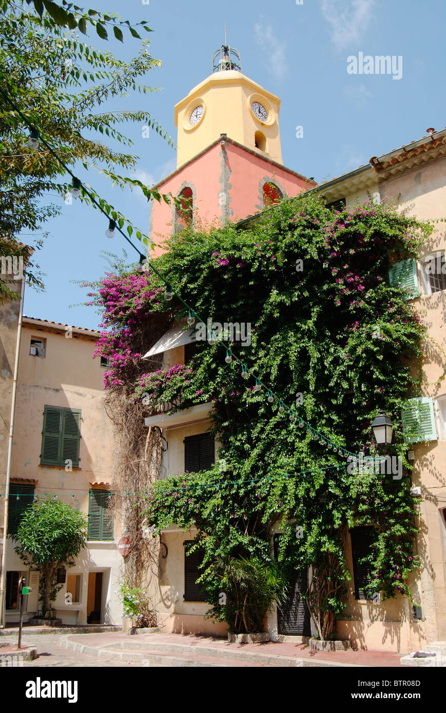 France, Saint-Tropez, View of creeper growing outside clock tower - Stock Image