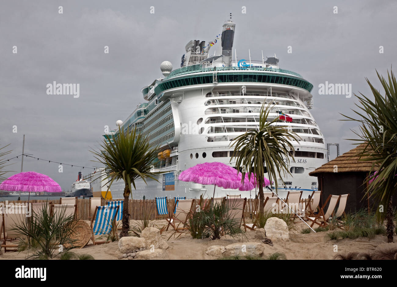 Royal Caribbean Independence of the Seas with a Promotional Shoreside Display, Southampton Water, Hampshire, England. - Stock Image