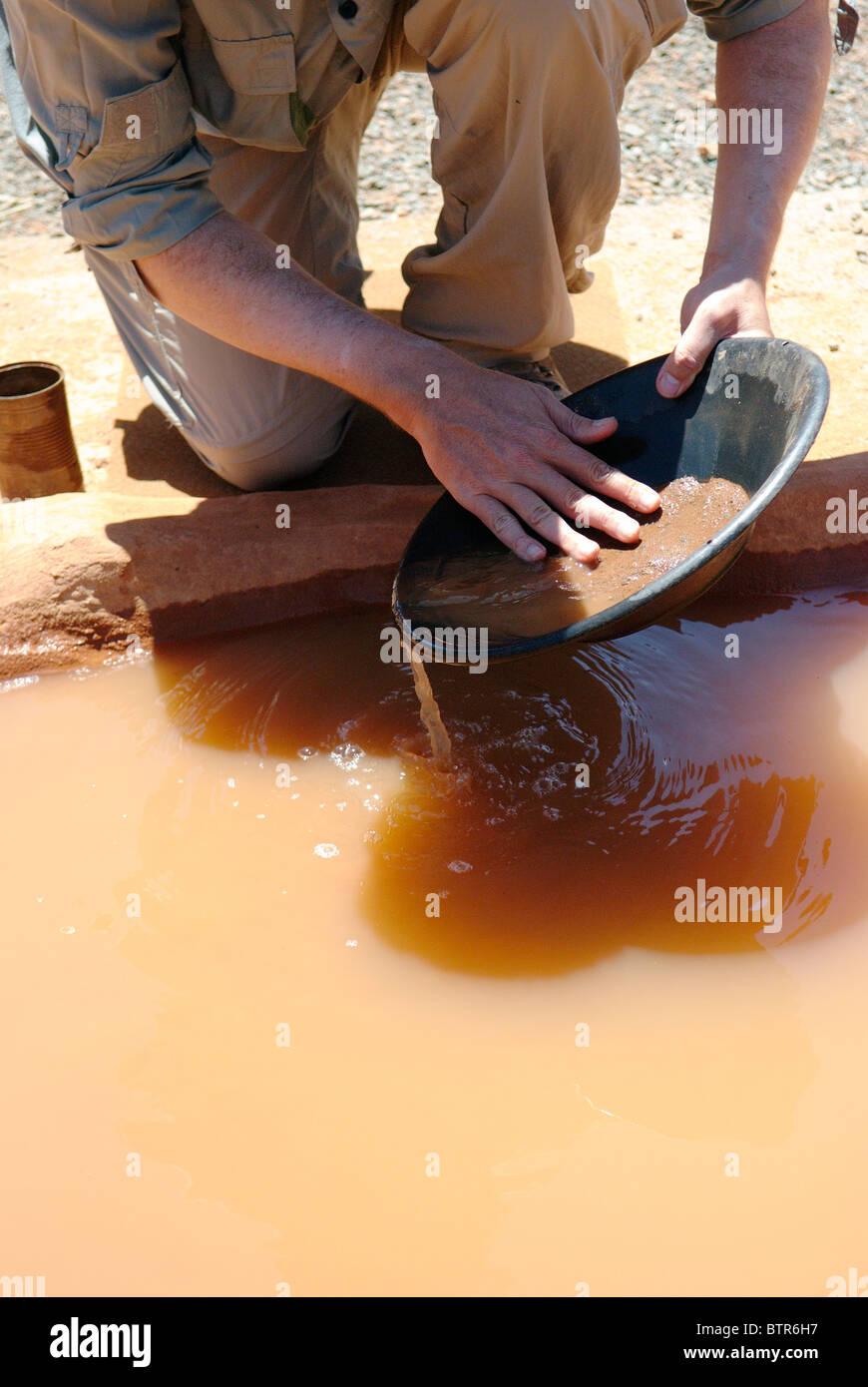 Australia, Kalgoorlie, Mining Hall of Fame, Person doing gold panning - Stock Image