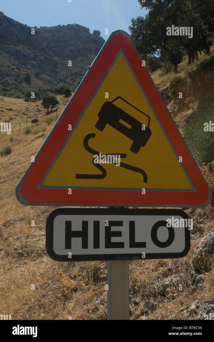 Slippery road sign, Spain - Stock Image