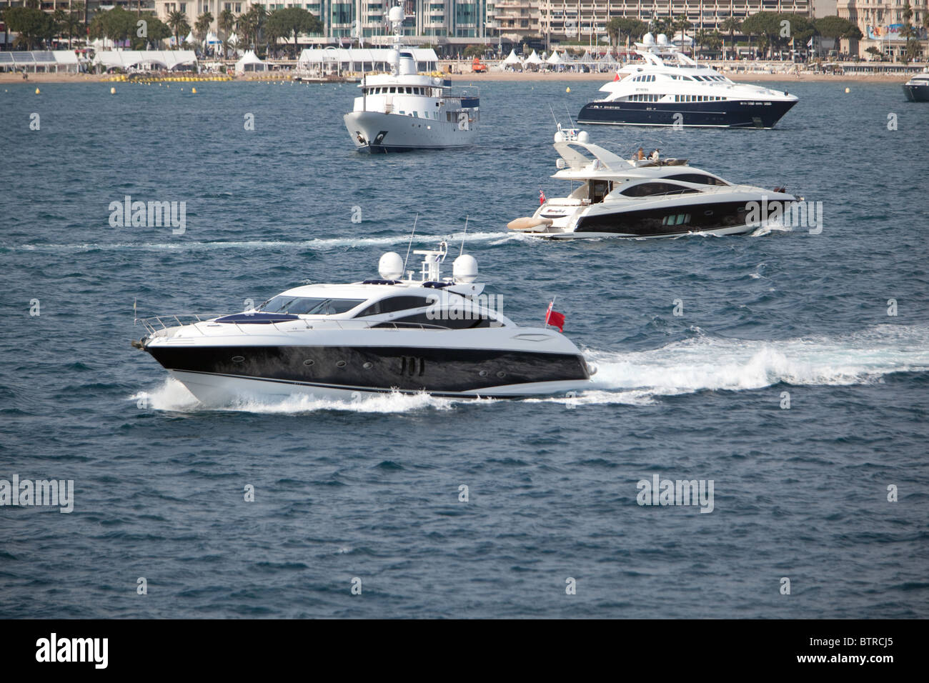A plethora of private and charter yachts attending Cannes Film Festival France. - Stock Image