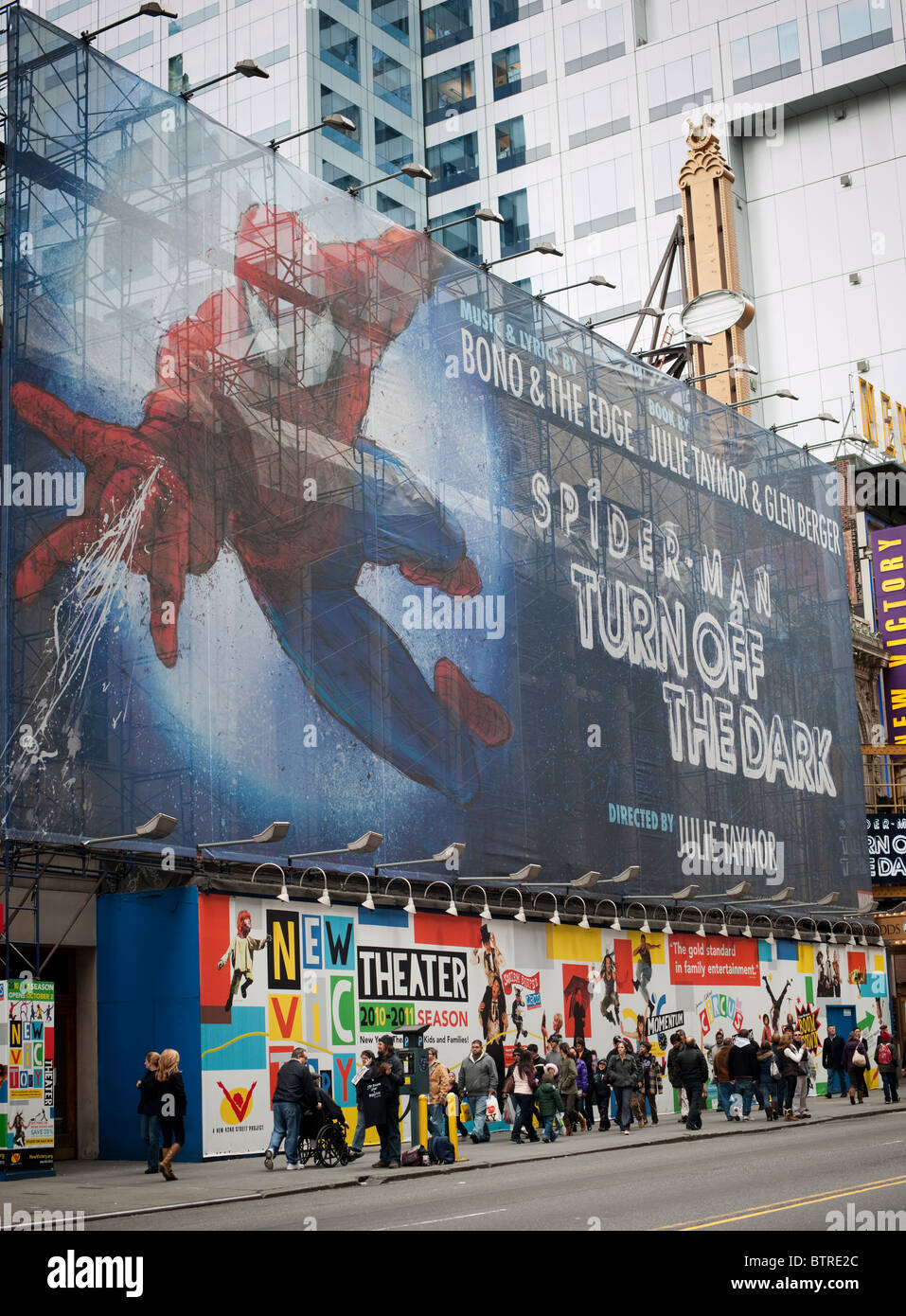 A poster advertising the 'Spider-Man Turn Off the Dark' Broadway musical is seen  on 42nd street in Times - Stock Image