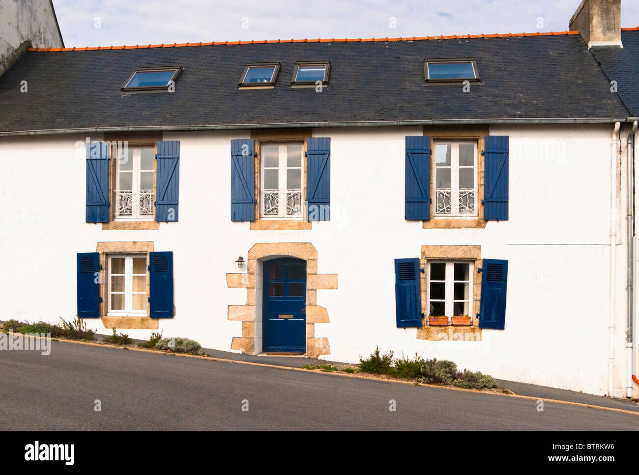 Typical French house with shutters on a hill in Doelan, Finistere, Brittany, France, Europe - Stock Image