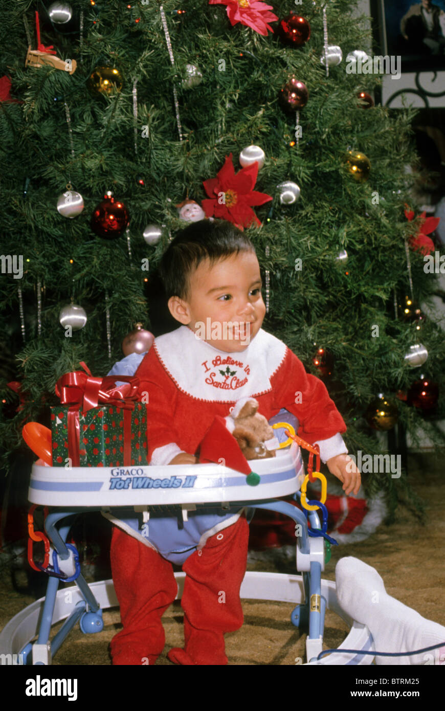 Hispanic baby boy Christmas tree costume smile happy laugh toy gift seat holiday event  sc 1 st  Alamy & Hispanic baby boy Christmas tree costume smile happy laugh toy gift ...