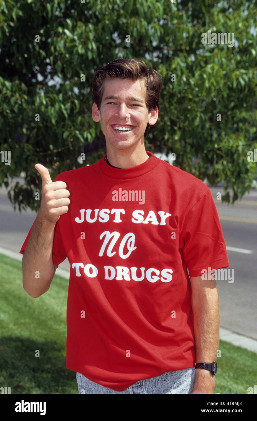 White boyl  teen male Just Say No to Drugs shirt red wear support fight slogan fight resist program campaign law - Stock Image