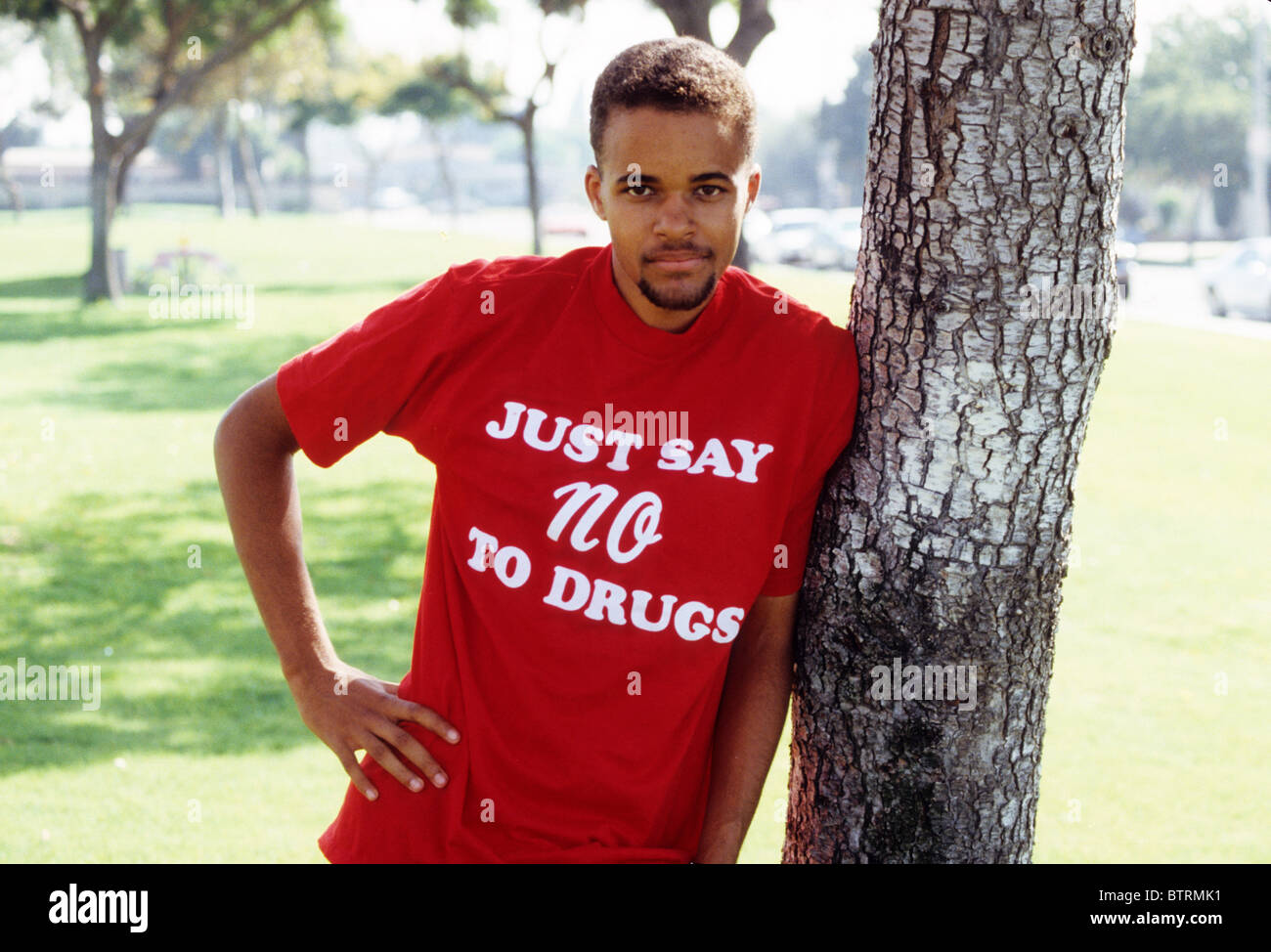 Black boy teen male Just Say No to Drugs shirt red wear support fight slogan fight resist program campaign law legal - Stock Image
