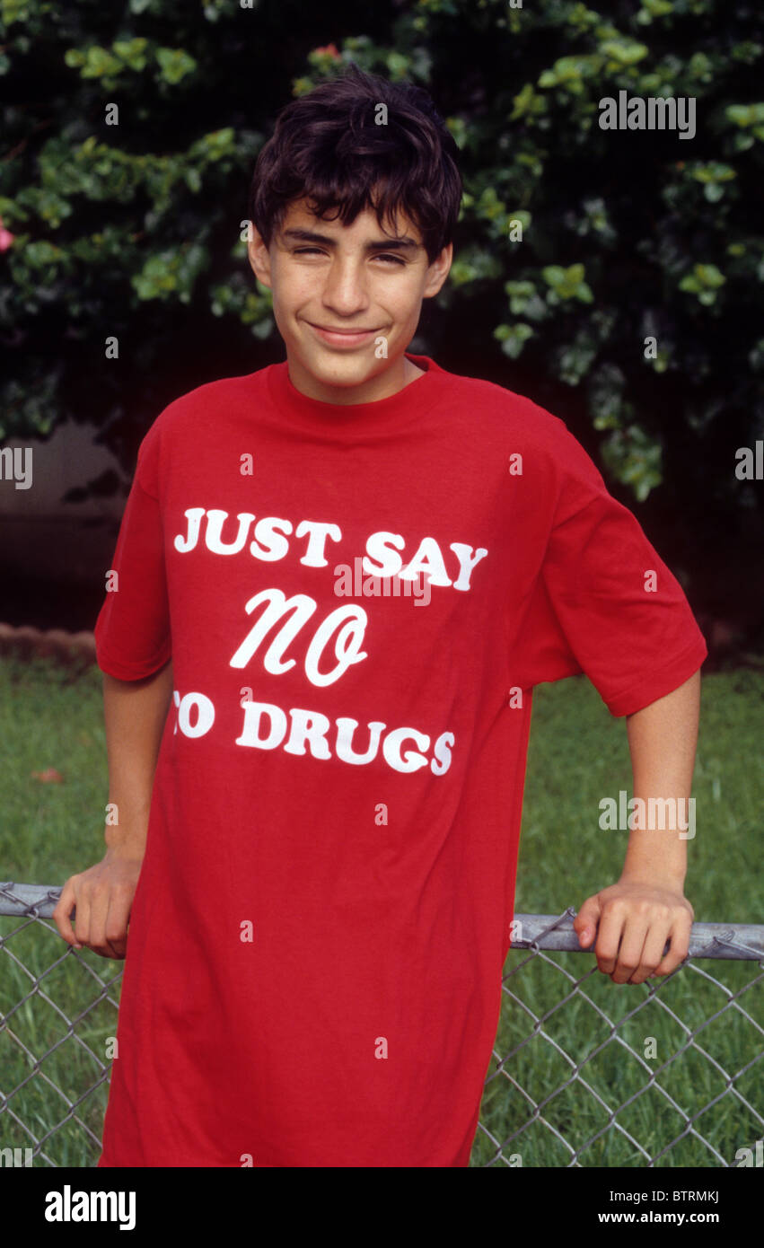 Hispanic boy teen male Just Say No to Drugs shirt red wear support fight slogan fight resist program campaign law - Stock Image