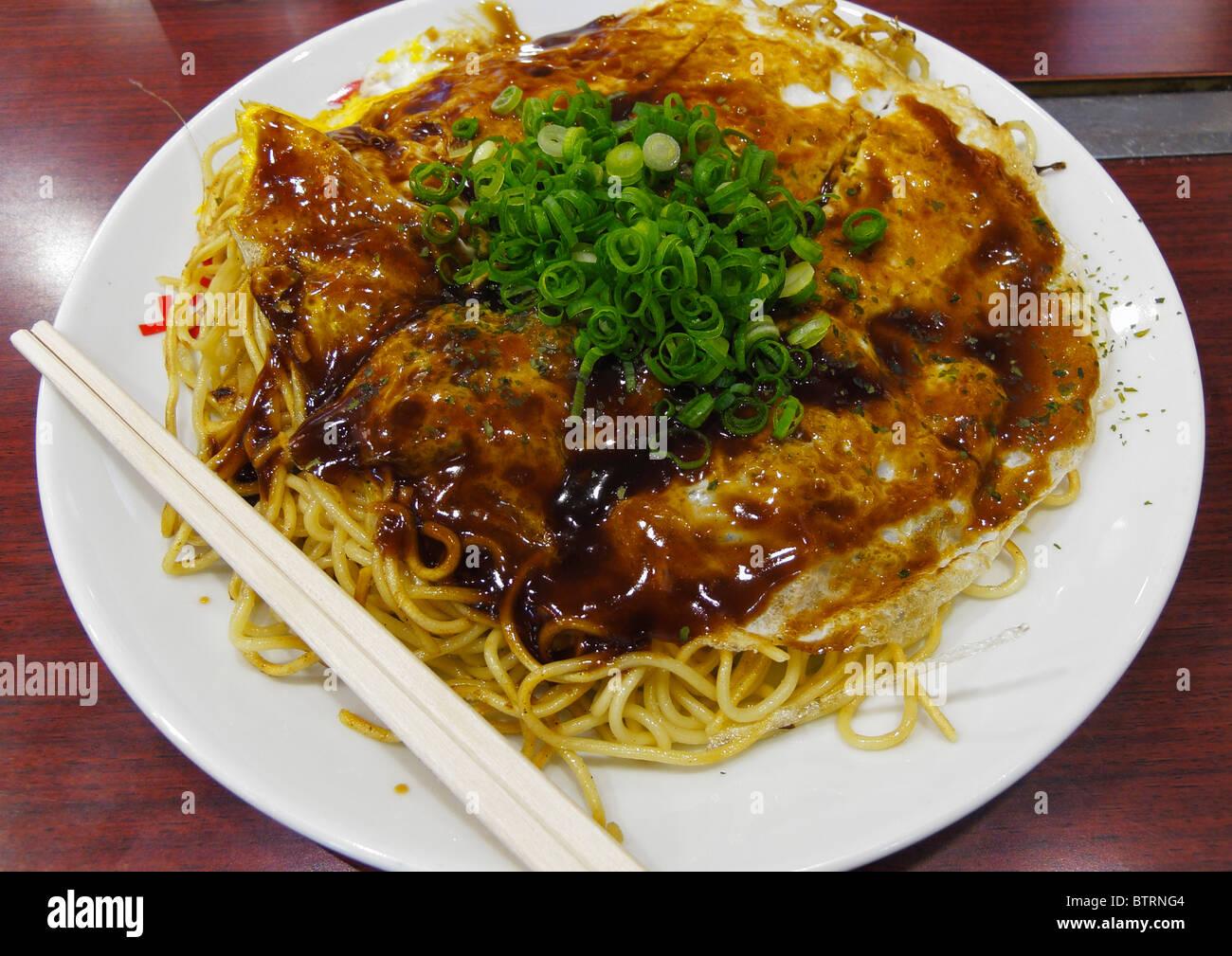 The famous Okonomiyaki dish from Hiroshima district, Hiroshima JP Stock Photo