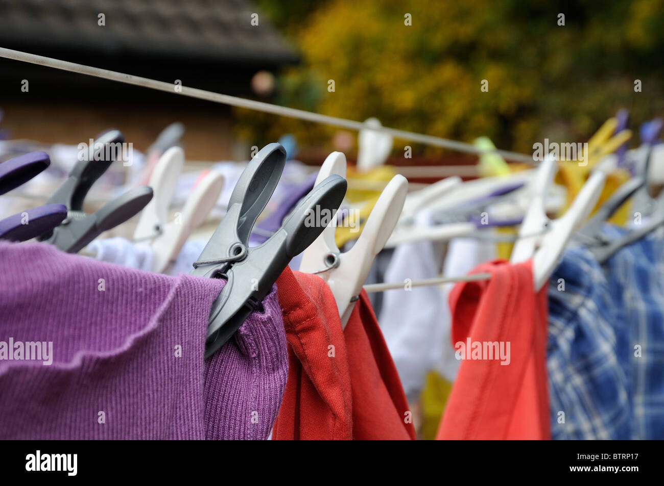 washing pegged out to dry - Stock Image