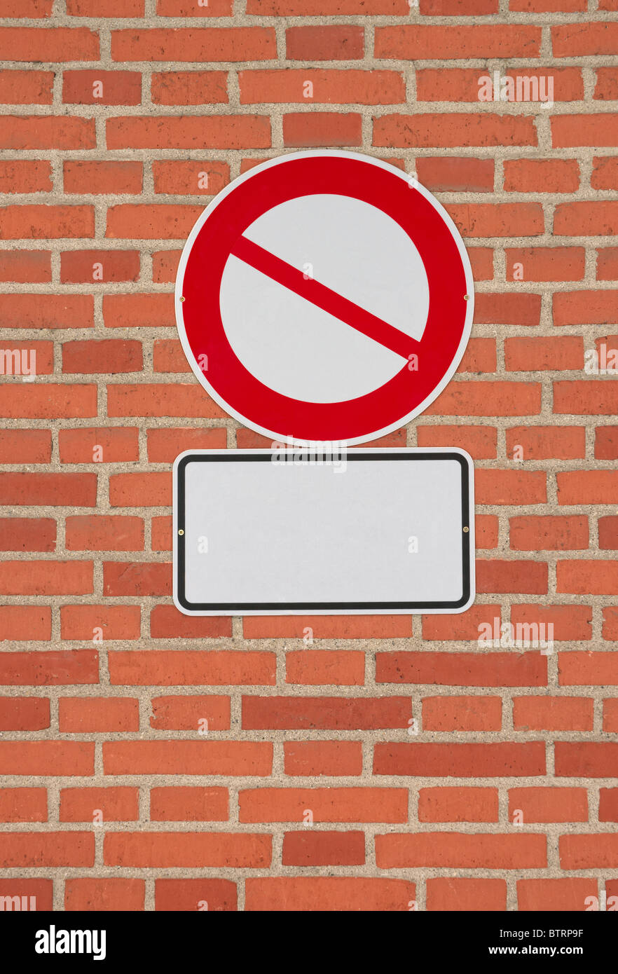Prohibition sign with blank letter plate on brick wall. Template to ...