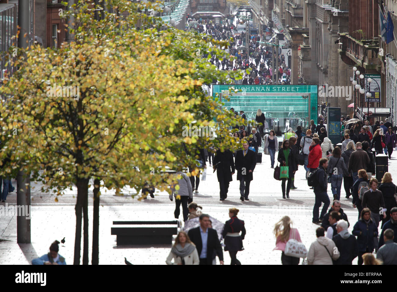 Pedestrians walking on Buchanan Street in autumn, Glasgow, Scotland, UK - Stock Image