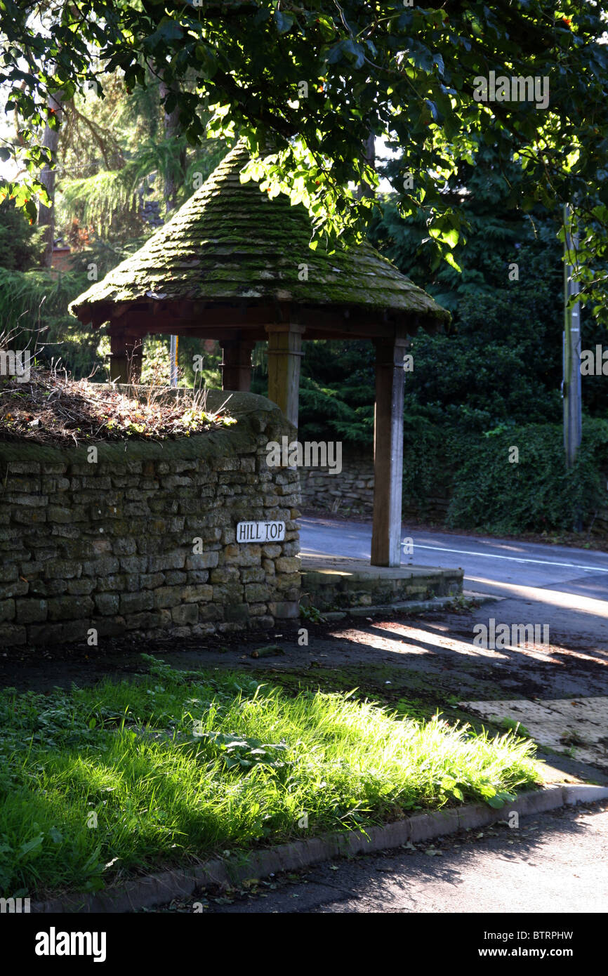 Old Well Site, Harmston Village Lincoln. Capped off well folly roofed and four posts. - Stock Image