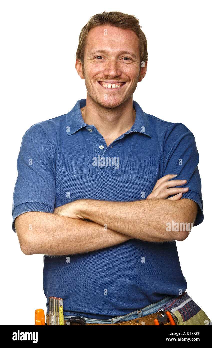 portrait of happy handyman on white background - Stock Image
